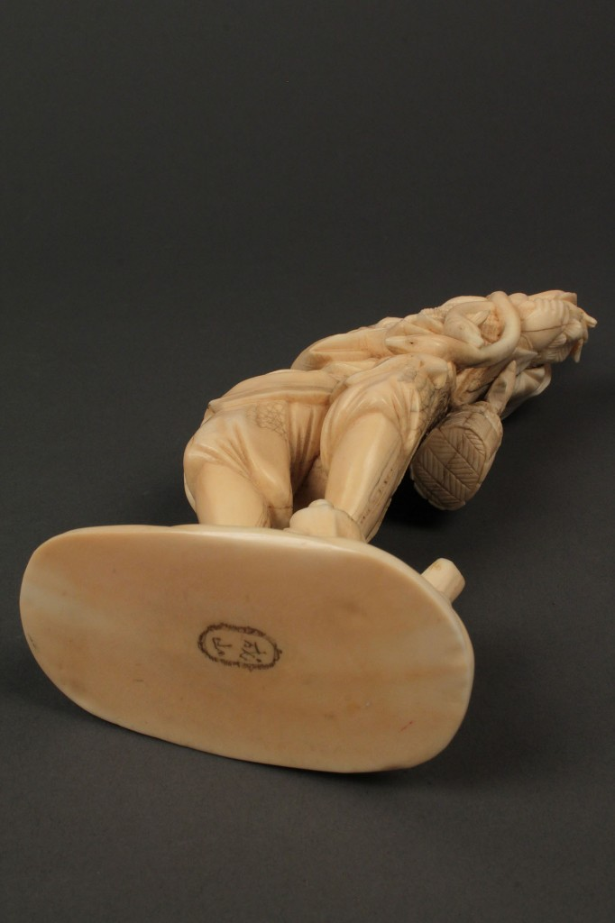 Lot 248: Asian ivory okimono figure, man with eels