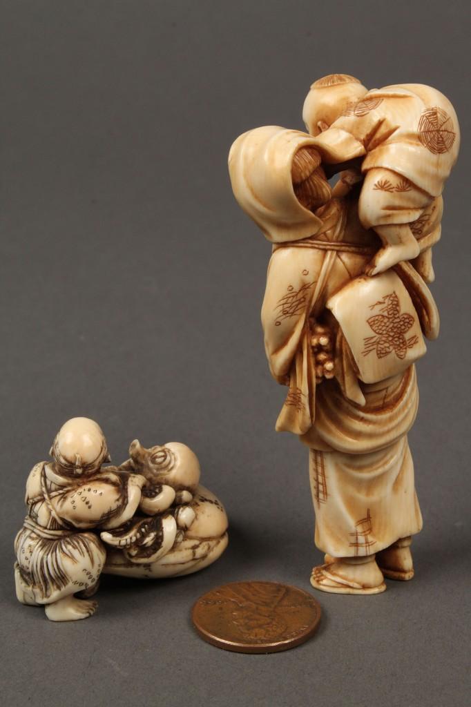Lot 254: Lot of 2 ivory netsuke, man w/ octopus and woman w/ child
