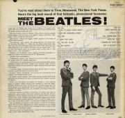 "Lot 281: ""Meet the Beatles"" album, signed by all 4 members"