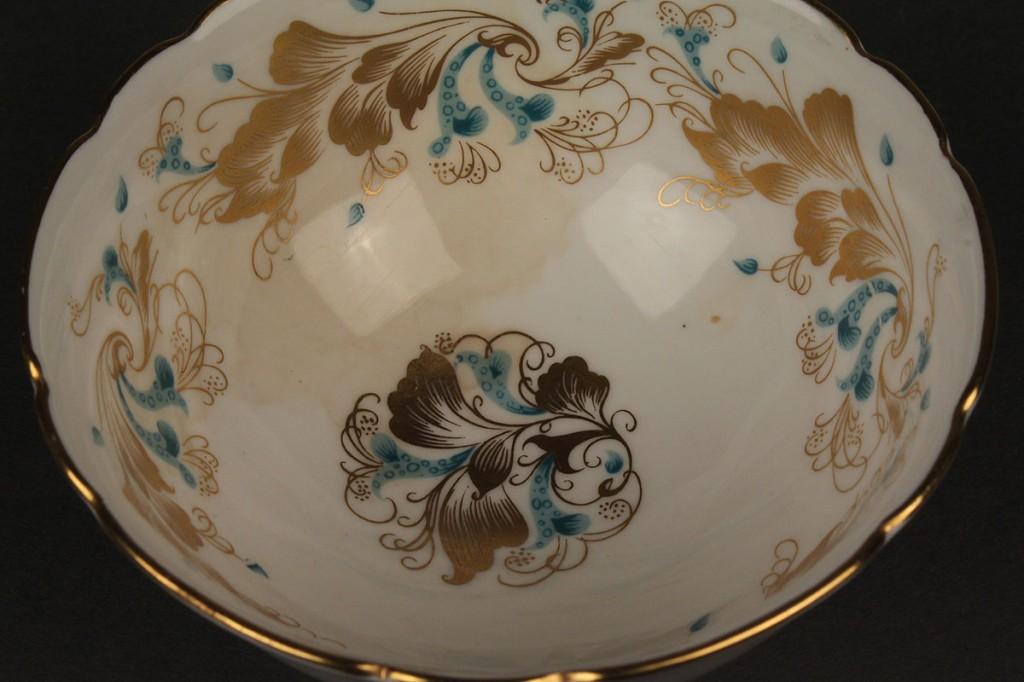 "Lot 348: 69 pcs. Coalport Dinnerware, ""Strange Orchid"" pattern"
