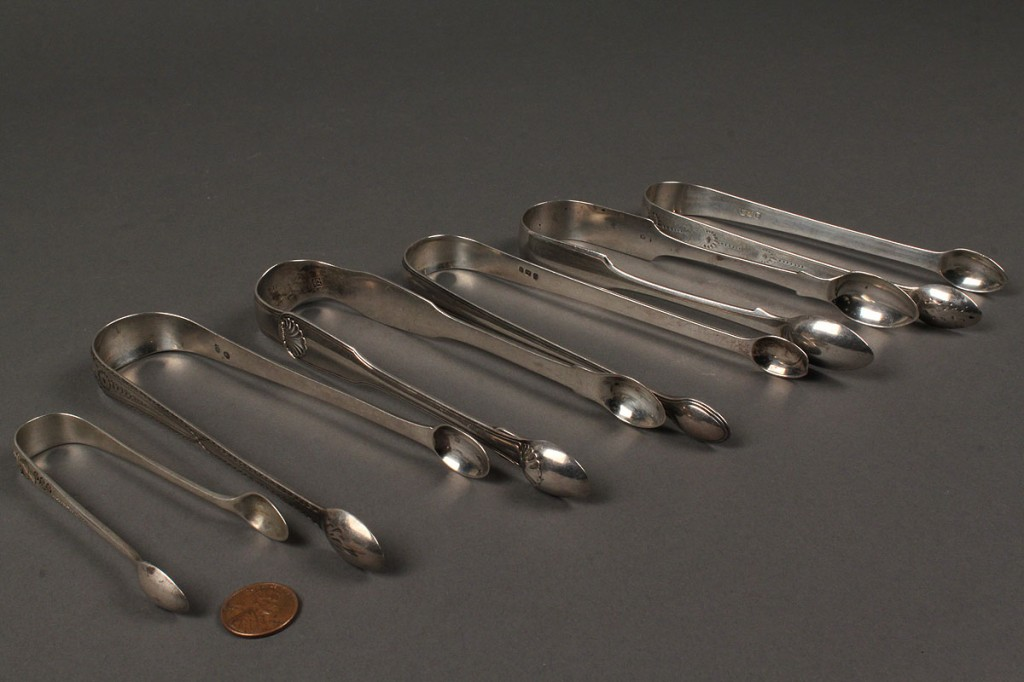 Lot 380: 6 English Sterling sugar tongs