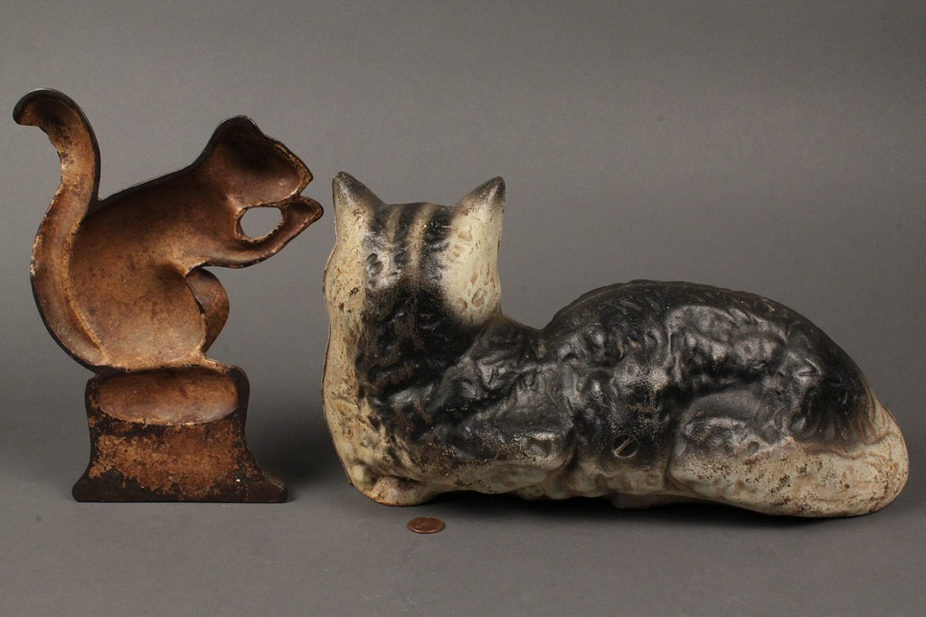Lot 41: Cast Iron Doorstops of Painted Squirrel and Cat