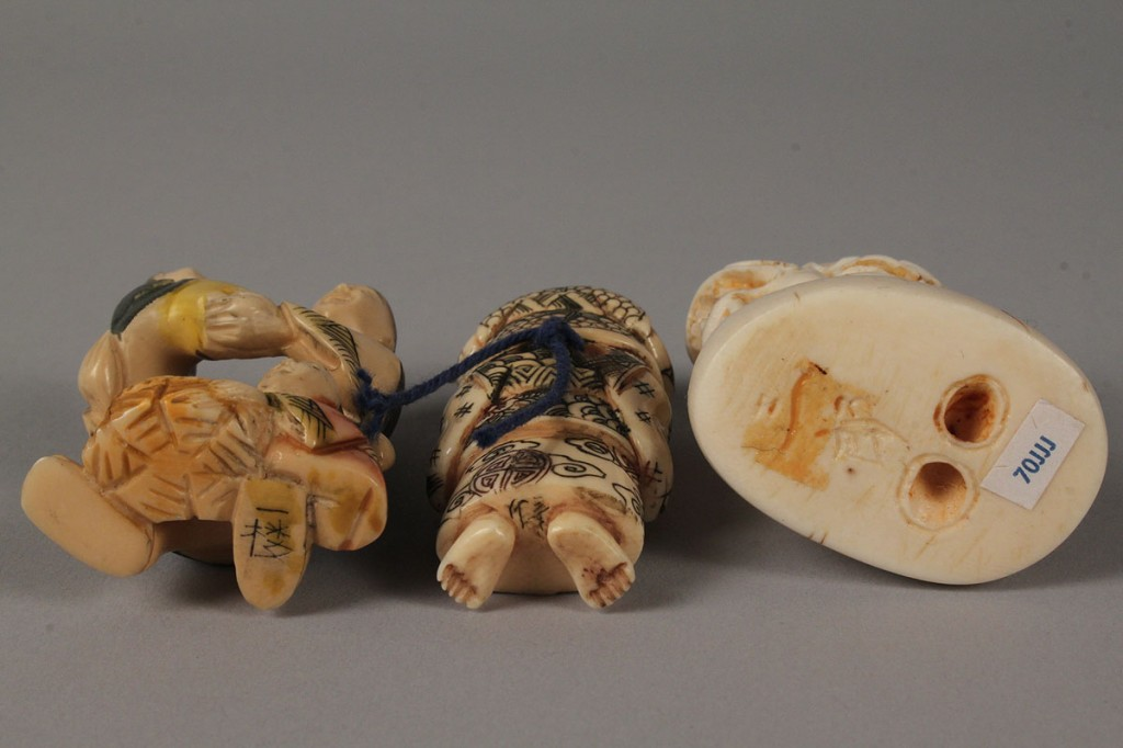 Lot 423: Three carved ivory Asian netsukes