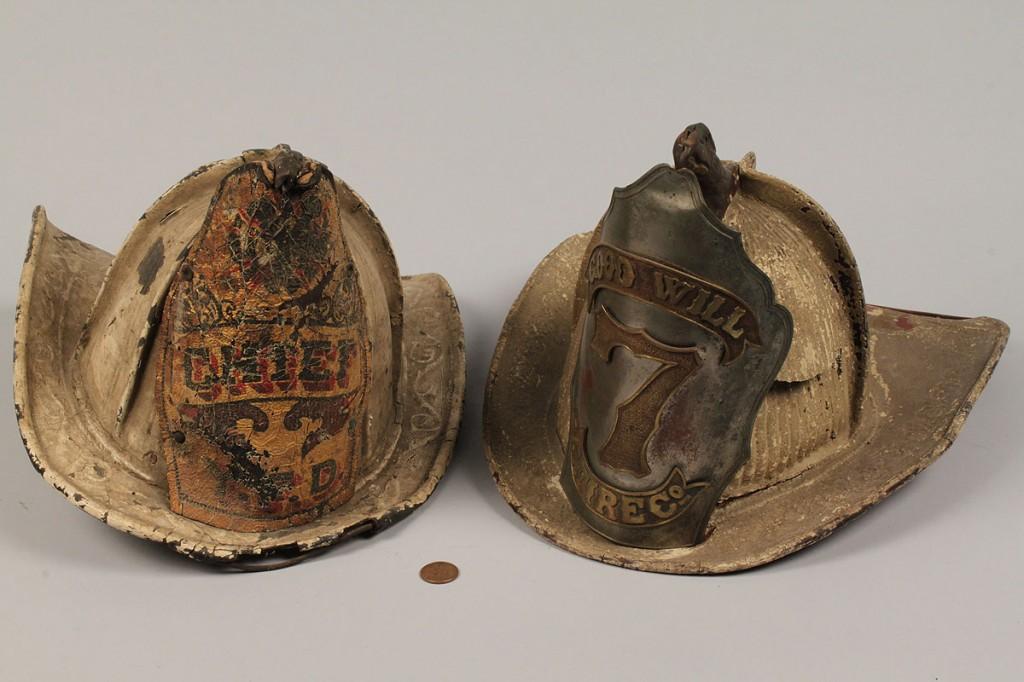 Lot 484: Lot of 4 19th century Fire Helmets