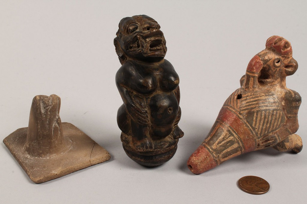 Lot 492: Lot of 3 ethnographic items: kris handle, stamp, whistle
