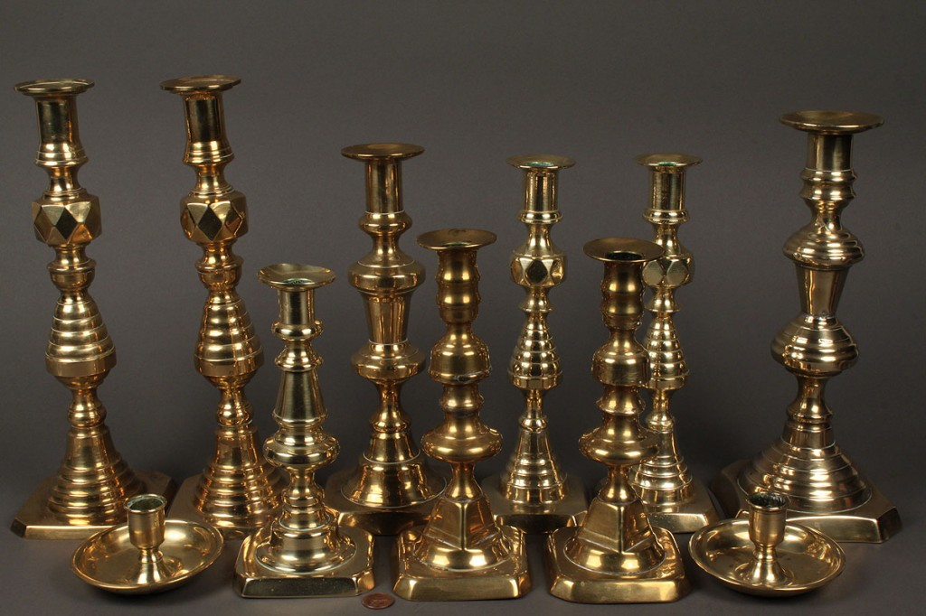 Lot 506: Lot of 11 early Brass Candlesticks