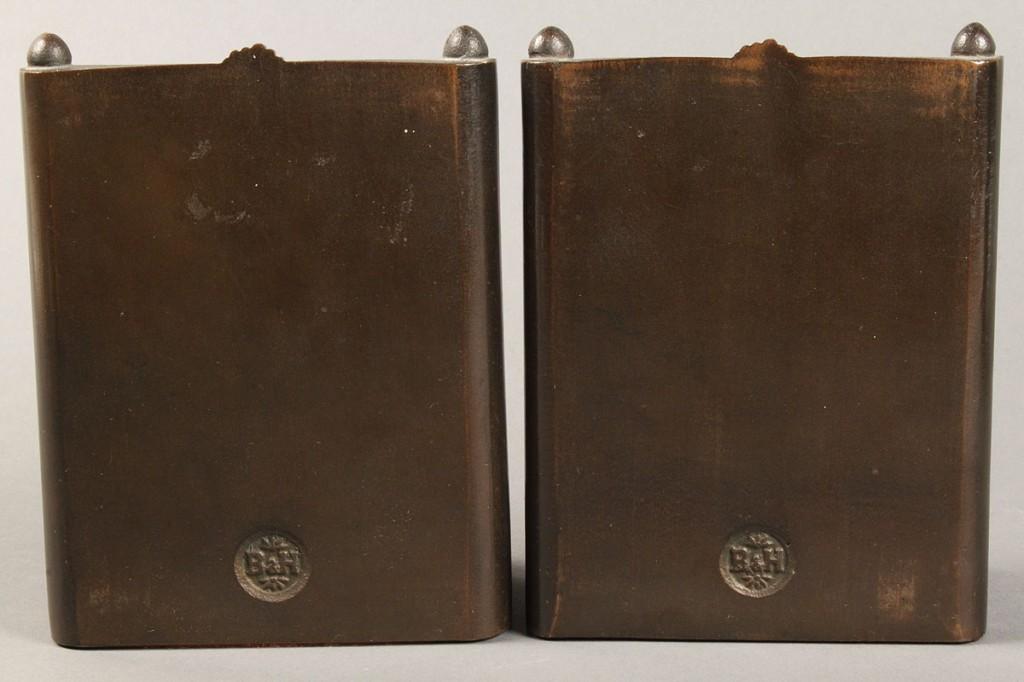 Lot 509: Bronze bookends and doorstop
