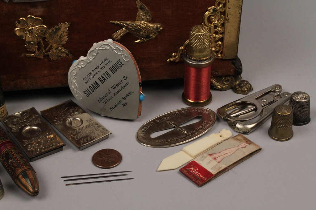 Lot 548: Velvet sewing box with assorted tools
