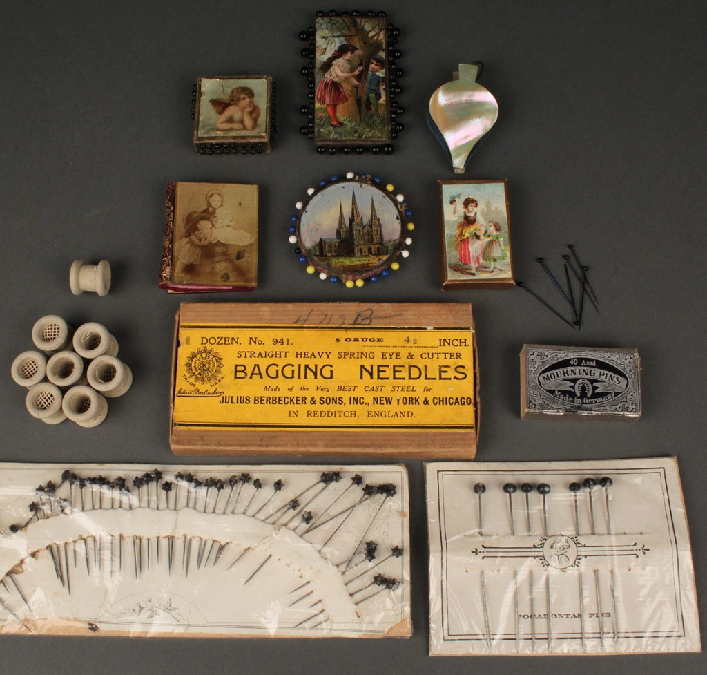 Lot 554: Collection of antique pin cushions, pins and reels