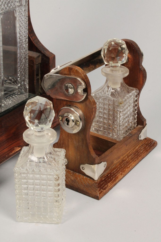Lot 595:  2 Glass Tantalus Sets, one miniature