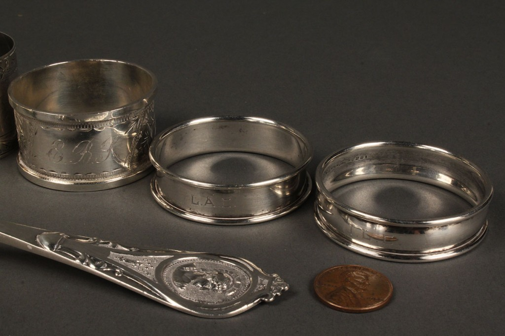 Lot 639: Albert Coles classical serving piece & 5 napkin rings