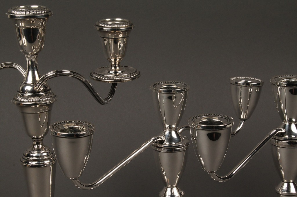 Lot 647: Three Sterling Candelabra