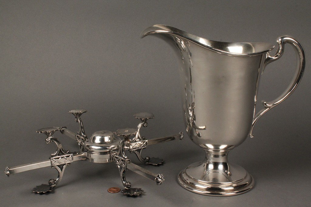 Lot 656: Silverplated dish cross and pitcher