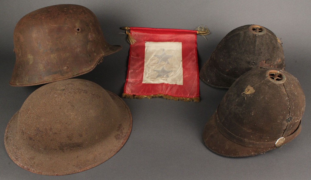 Lot 710: Lot of 2 World War I helmets &  2 19th Century Army Spike Helmets, 4 items