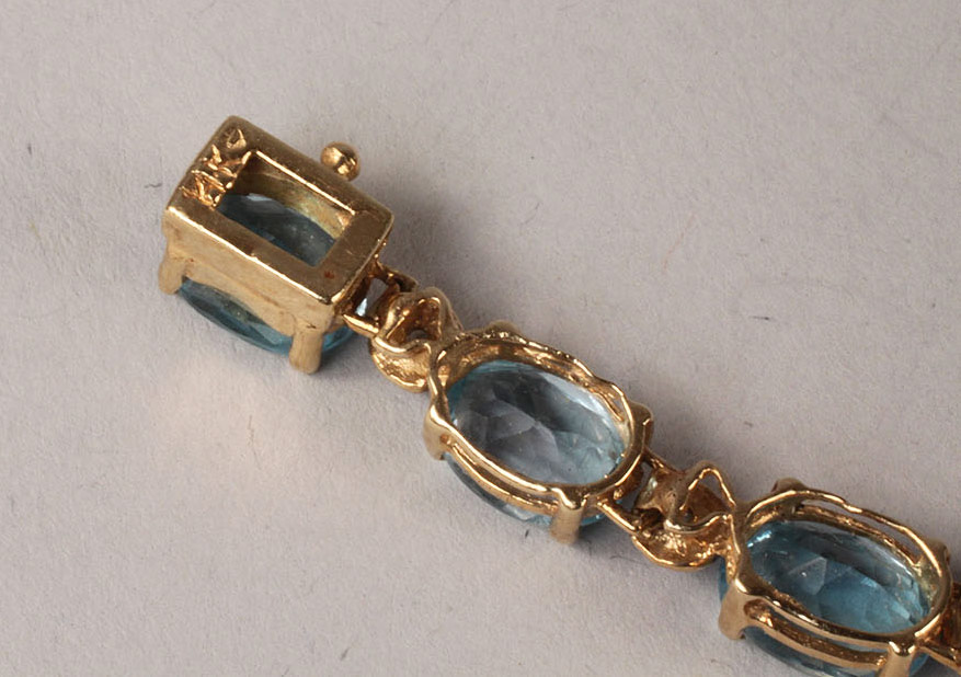 Lot 112: Grouping of Blue Topaz Jewelry, 4 pieces