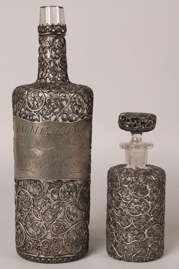 Lot 113: Lot of 2 Pewter Overlay Bottles