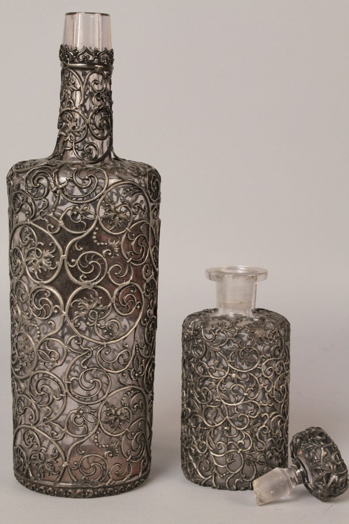 Lot 113: Lot of 2 Pewter Overlay Bottles