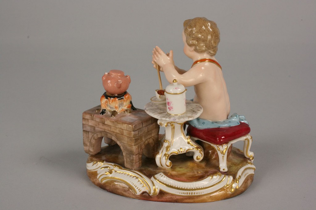 Lot 118: Meissen Figurine of cherub making tea