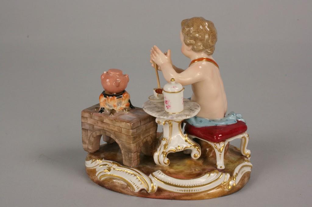 Lot 118: Meissen Figurine of cherub making tea