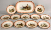 126: Limoges Porcelain Game Service, 11 plates & 1 plat