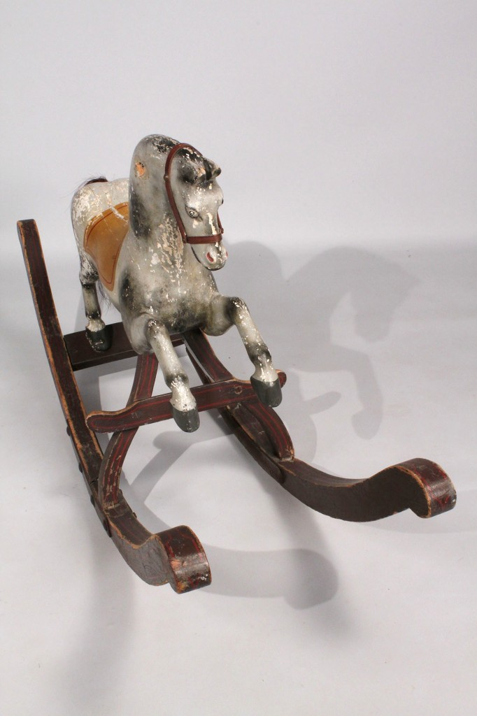 Lot 196: Carved and painted rocking horse