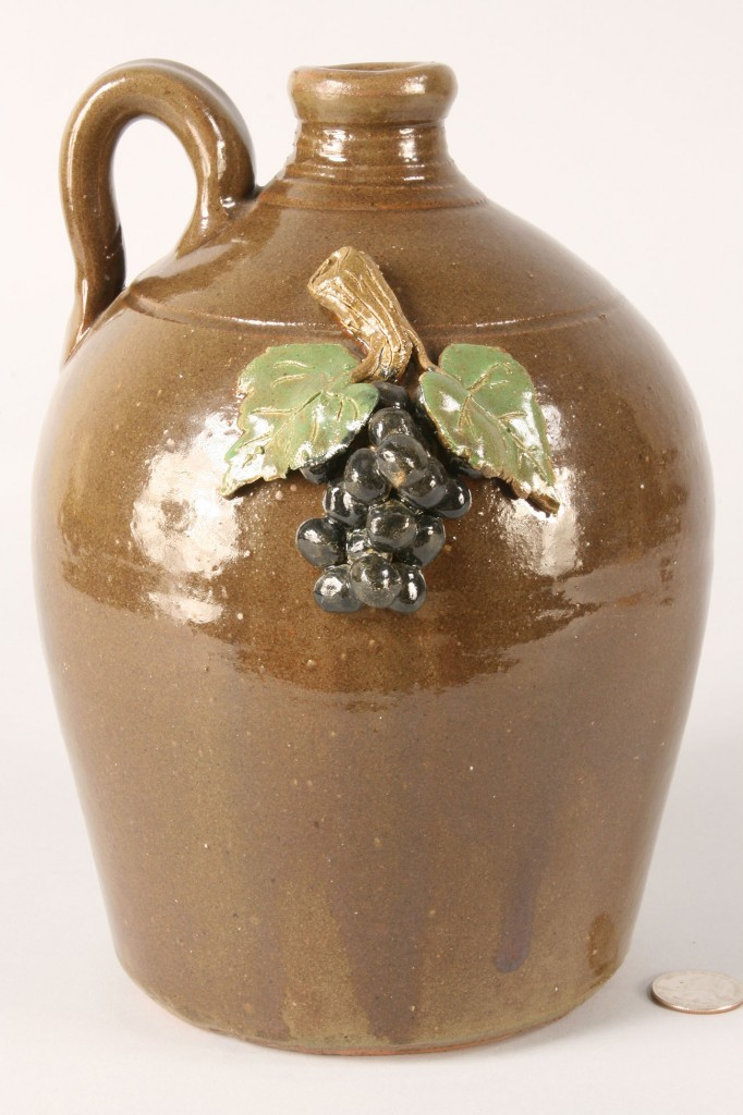 Lot 240: 2 GA pottery Jugs, Grape Motif, Bobby Ferguson and