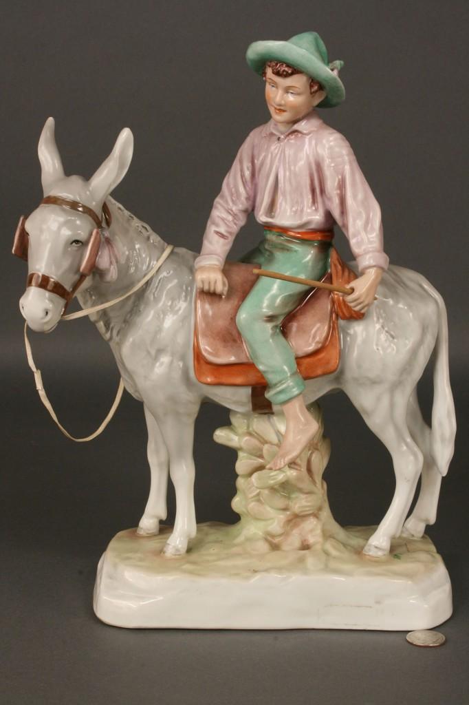 Lot 252: Royal Dux Figure of Boy on Donkey