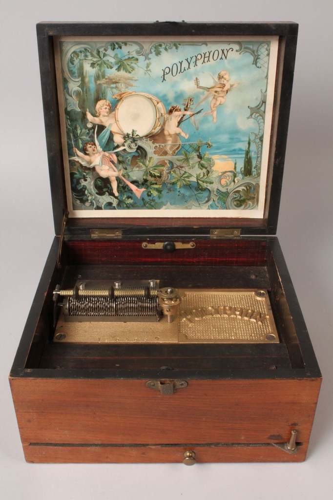 Lot 264: Polyphon wooden music box with discs