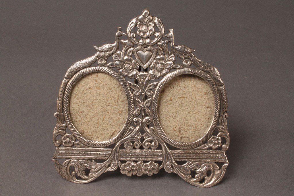Lot 300: Sterling silver double picture frame and four cups