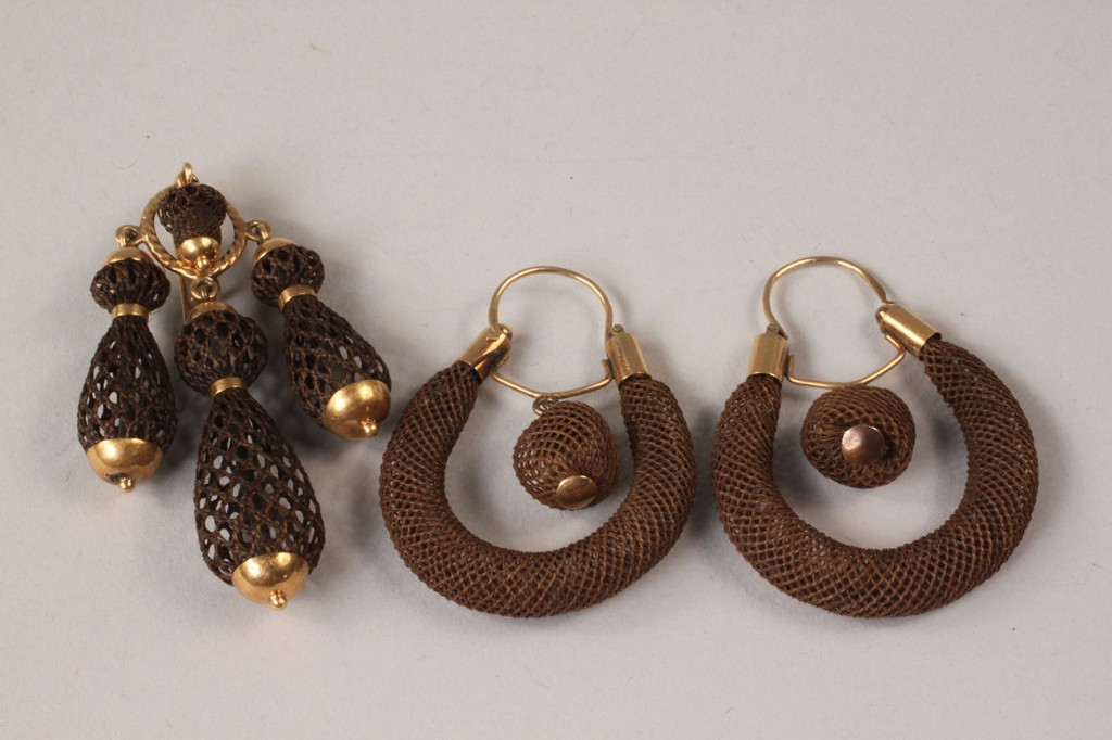 Lot 317: Victorian hair open work earrings and brooch