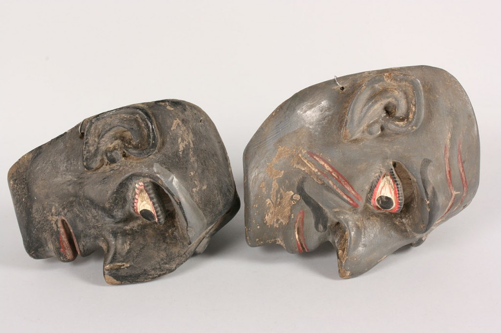 Lot 338: 2 Mexican Folk art Hermit masks, black and red pai