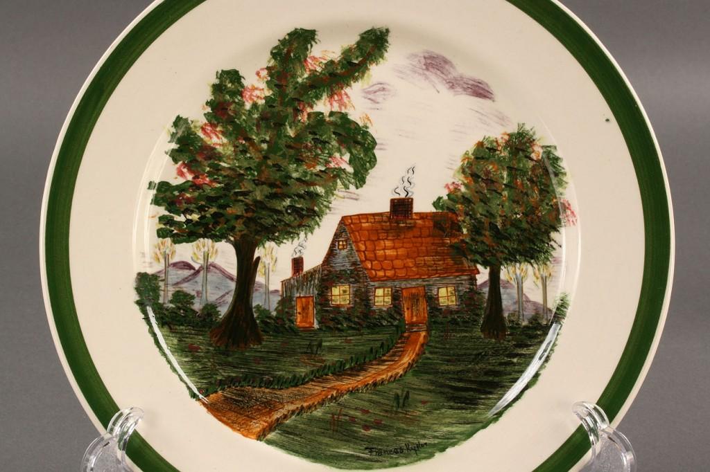 Lot 402: Blue Ridge Porcelain Cabin scene plate, sgd Kyker
