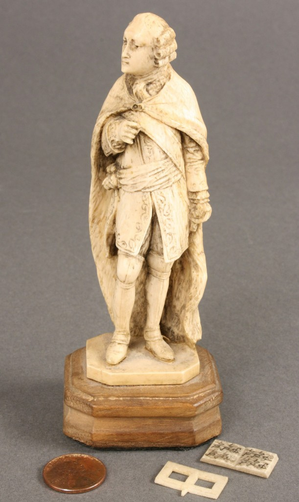 Lot 425: Carved ivory figure of a gentleman