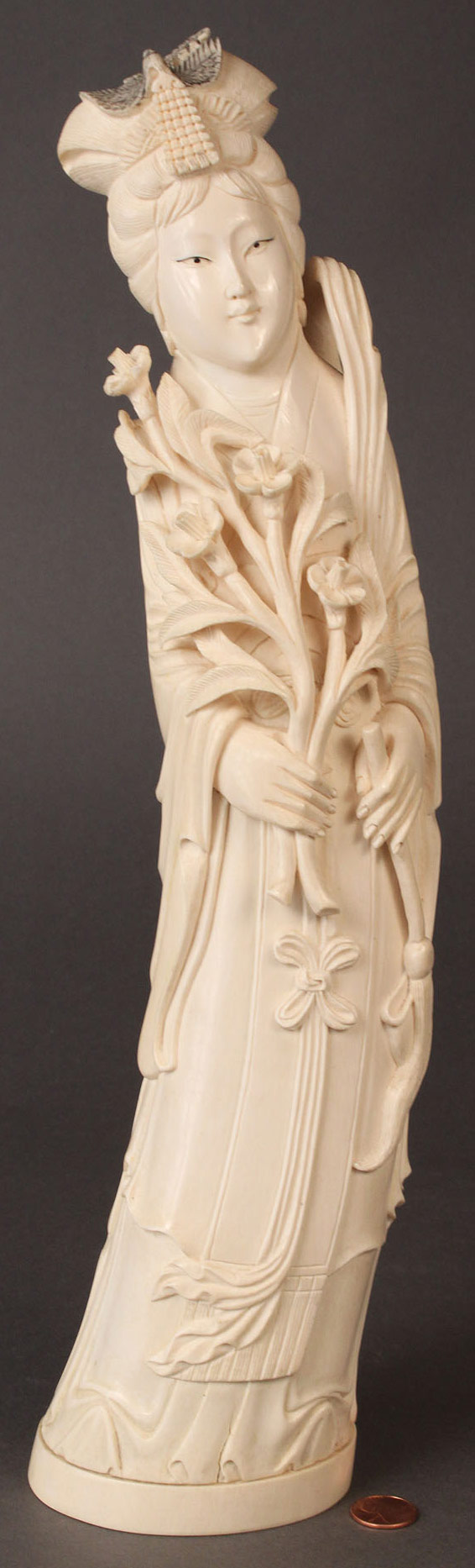 429: Carved Ivory Figure from an elephant tusk