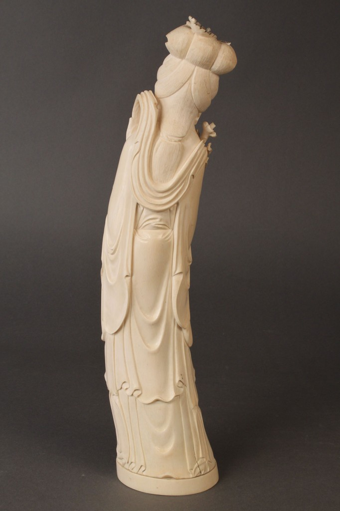 Lot 429: Carved Ivory Figure from an elephant tusk