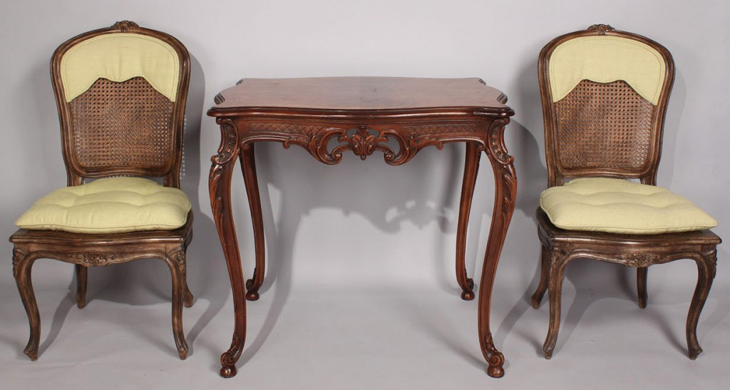 Lot 479: Louis XV table and pair of chairs