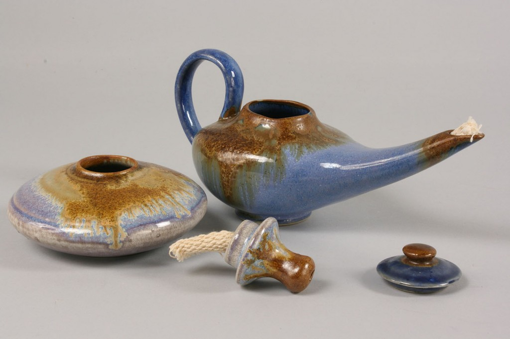 Lot 494: Pigeon Forge blue glazed tea set and 2 oil lamps