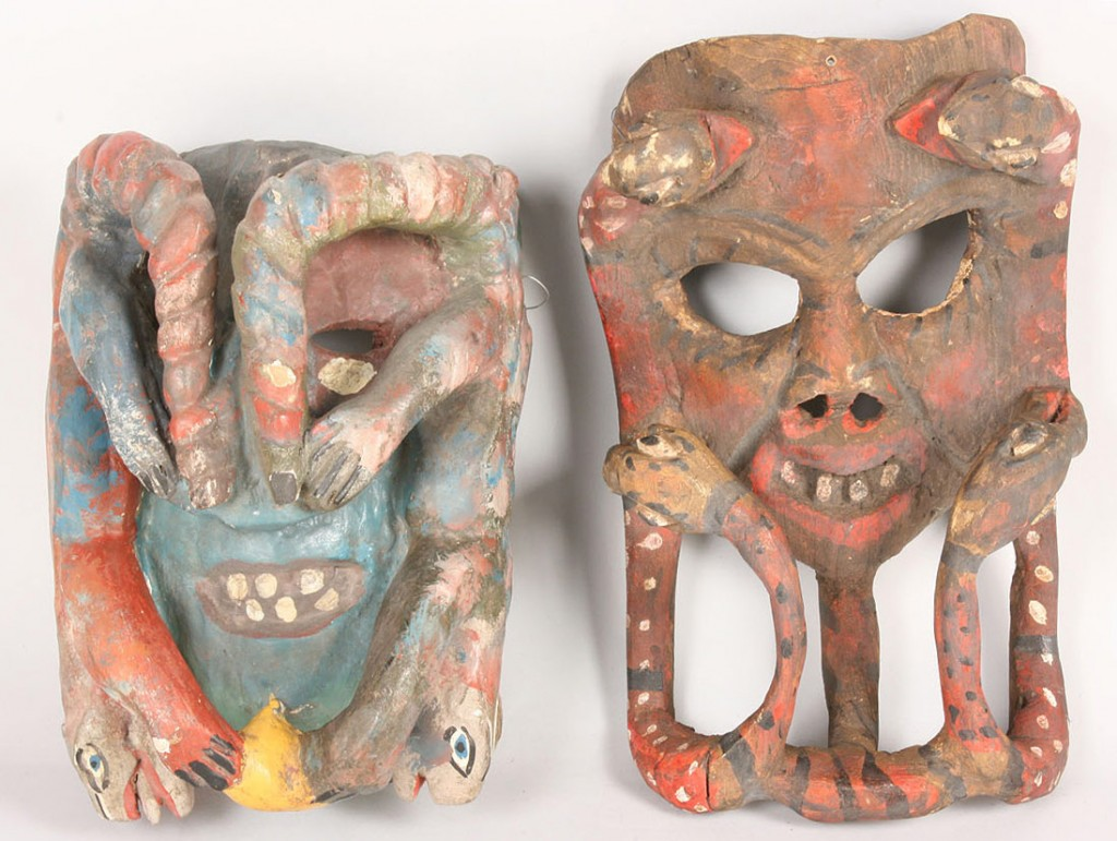 "Lot 508: Pr Mexican Folk Art ""Mother"" masks for Snake dance"