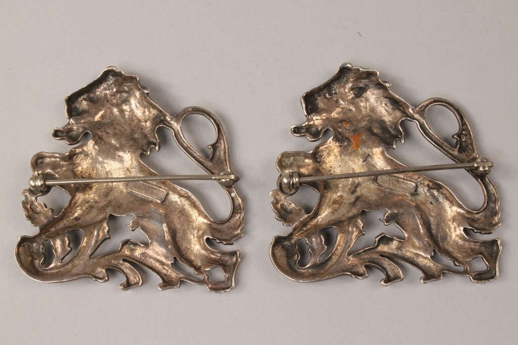 Lot 586: Pair Ciner Sterling Silver Lion Pins