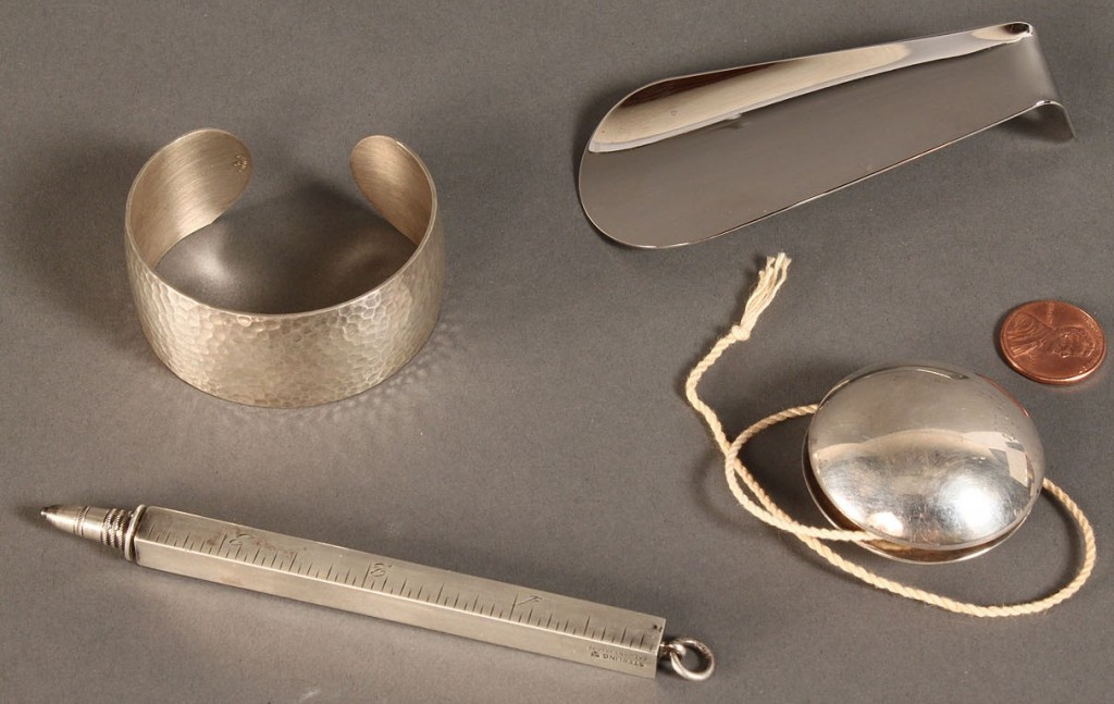 Lot 607: Four sterling silver novelty items