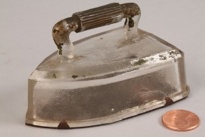 Lot 646: Flat Iron Candy Container