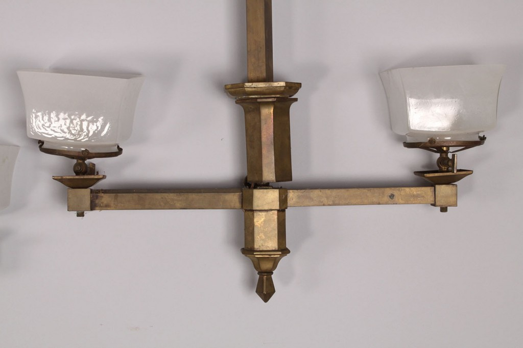 Lot 688: Two brass gasoliers with square glass shades