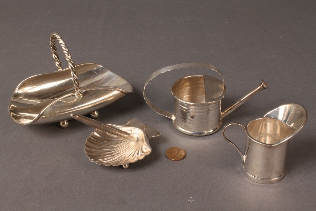 Lot 88: Four Cartier and Tiffany Sterling Silver novelties