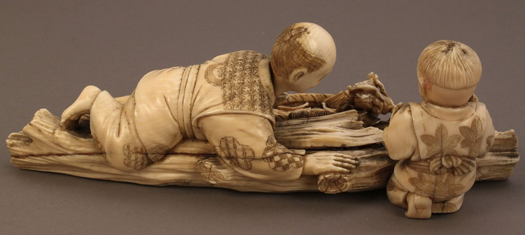 Lot 12: Ivory Okimono figure, boy and father with frogs