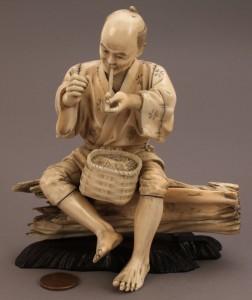 Lot 13: Ivory Okimono figure, man smoking a pipe