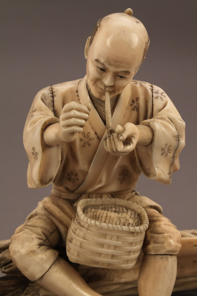 Lot 13: Ivory Okimono figure, man smoking a pipe