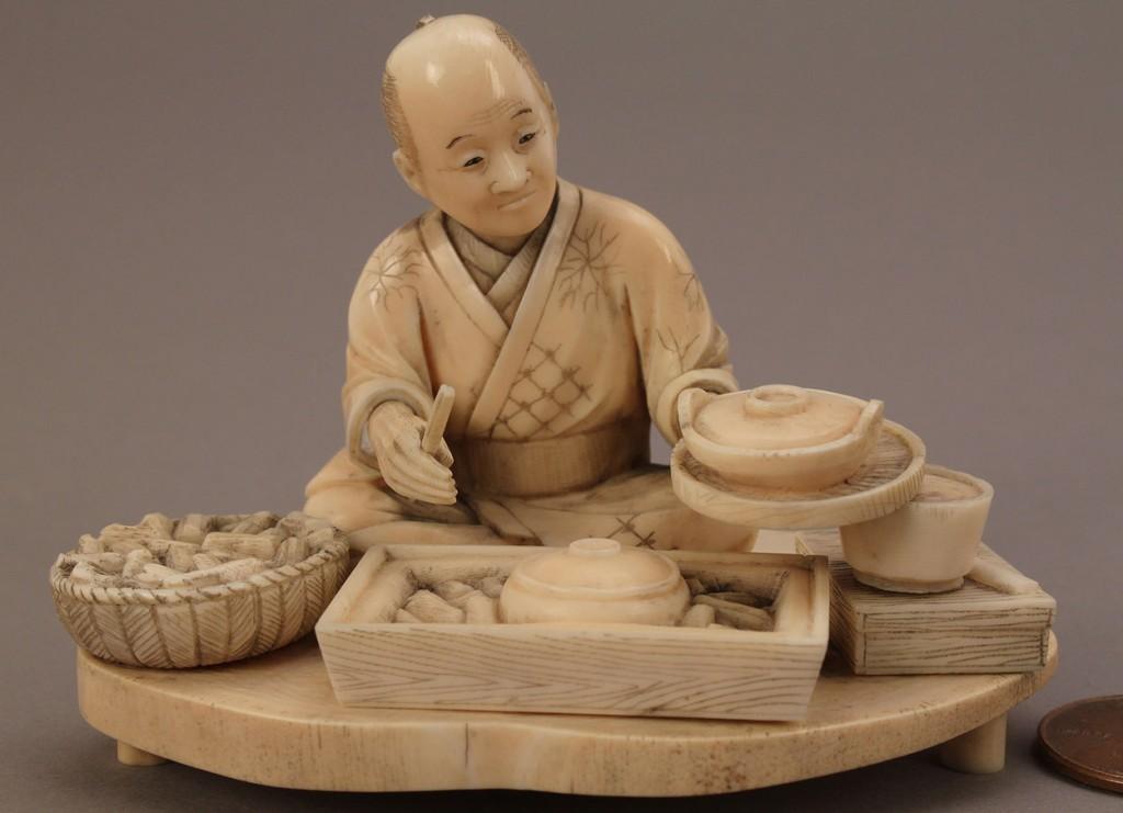 Lot 14: Ivory Okimono figure, man cooking