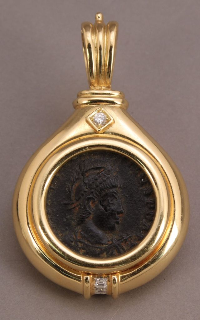 Lot 157: Roman Coin in 18K pendant with diamonds