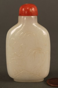 Lot 15: Carved white Jade snuff bottle, Qing dynasty