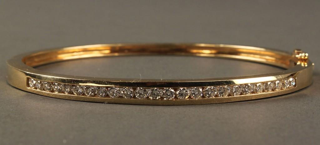 Lot 166: 14K Diamond bangle bracelet, 1.78 cts